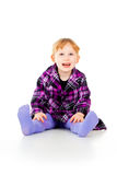 A little girl in a dress, have fun, sits Royalty Free Stock Photos