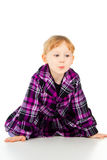 A little girl in a dress, have fun, sits Royalty Free Stock Photo