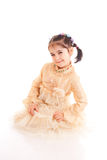 The little girl in a dress isolated on a white Royalty Free Stock Photography