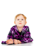 A little girl in a dress, a look of surprise Stock Photography