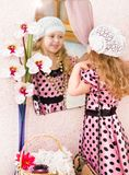 Little girl in dress looking in mirror Royalty Free Stock Image