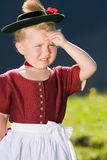 Little girl in a dress looks in the country Stock Image