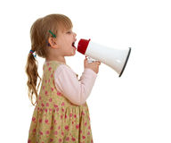Little girl in dress with megaphone Royalty Free Stock Photography