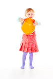 A little girl in a dress, playing with a balloon Royalty Free Stock Images