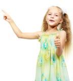Little girl in dress pointing the finger stock images