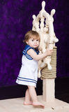 Little girl in a dress in sailor's style stock image