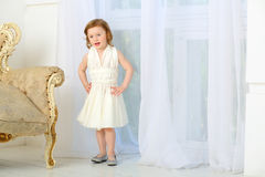 A little girl in dress sings a song Stock Images