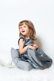 Little girl in a dress sitting Stock Photo