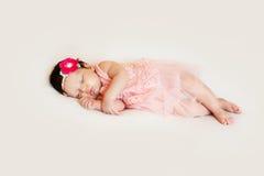 Little girl in dress sleeping on white blanket royalty free stock images