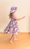 Little girl in dress twisting around. Blurred motion Royalty Free Stock Photography