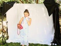 Little girl dress-up. Little girl pretending to dress-up for photshoot Stock Images