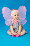 Little girl in a dress and wings Stock Photo