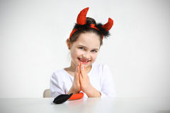 Little girl dressed as. Pretty imp Stock Photography