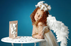 Little girl dressed as an angel Stock Images