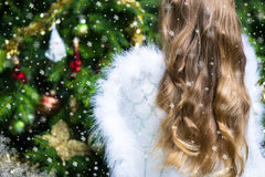 Little Girl Dressed as an Angel with Wings is decorating the Chr Stock Image