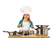 Little girl dressed as a chef having fun Royalty Free Stock Photos