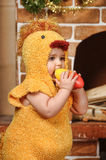 Little girl dressed as a chicken Stock Photo