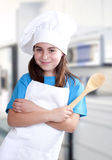 Little girl dressed as a cook Royalty Free Stock Photography