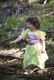Little girl dressed as a fairy with soap bubbles Stock Images