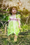 Little girl dressed as a fairy standing in forest Royalty Free Stock Photography