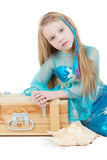 Little girl dressed as mermaid sits near to chest Stock Photos