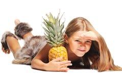 Little girl dressed as prehistoric man. On white background stock photo