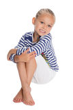 Little girl dressed as a sailor boy Stock Photo