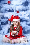 Little girl dressed as Santa Claus Stock Images