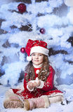 Little girl dressed as Santa Claus Royalty Free Stock Image