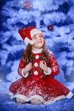 Little girl dressed as Santa Claus Stock Photography