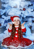 Little girl dressed as Santa Claus Stock Photos