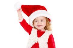 Little girl dressed as Santa Claus. Stock Photos