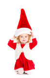 Little girl dressed as Santa Claus. Stock Photo