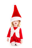 Little girl dressed as Santa Claus. Stock Photography