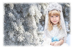 Little girl dressed as snowflakes Stock Photos