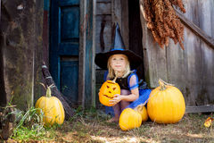 A little girl dressed as a witch for Halloween. Little girl dressed as a witch for Halloween Stock Images