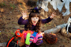 A little girl dressed as a witch for Halloween. Little girl dressed as a witch for Halloween royalty free stock images