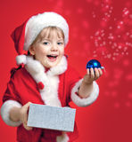 Little Girl Dressed In Santa Claus Stock Photo