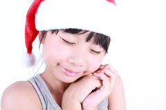 Little girl dressed like a santa claus Stock Images