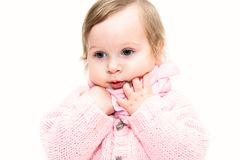 Little girl dressed in pink warm clothes and scarf Royalty Free Stock Photo