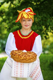 Little girl is dressed in the Russian national dress in summer p Stock Photo