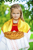 Little girl is dressed in the Russian national dress in summer p Royalty Free Stock Photography
