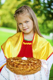 Little girl is dressed in the Russian national dress in summer p Stock Photography