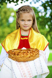 Little girl is dressed in the Russian national dress in summer p Royalty Free Stock Image