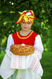 Little girl is dressed in the Russian national dress in summer p Stock Images