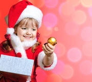 Little girl dressed in Santa Claus Royalty Free Stock Photo