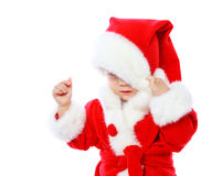 Little girl dressed in Santa Claus Stock Photos