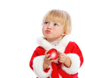 Little girl dressed in Santa Claus Stock Image