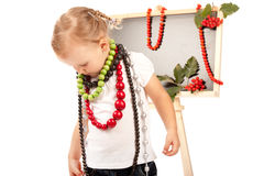 Little girl dressed up in jewelry Stock Photo