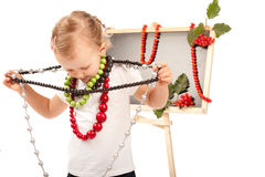Little girl dressed up in jewelry Stock Image
